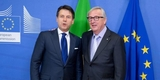 Giuseppe Conte, on the left, and Jean-Claude Juncker