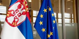 Serbian flag, on the left, and the European Union flag
